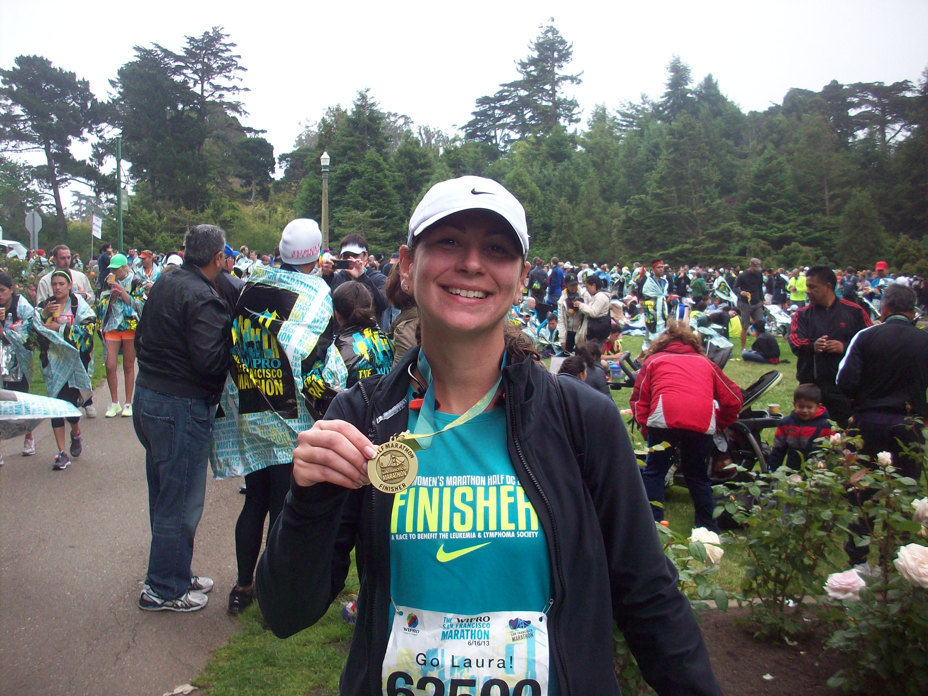 Proud finisher- 13.1 #14 done and done!
